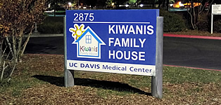 the sign in front of the Kiwanis Family House
